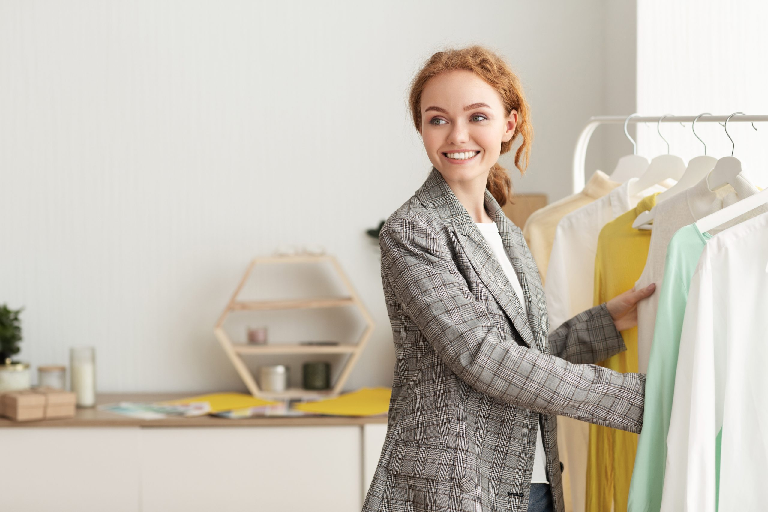 Happy woman buying new clothes in showroom